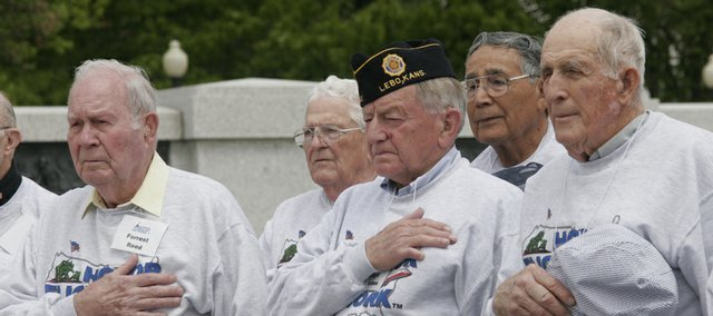 Veterans listen as the national anthem is sung during a ceremony at the World War II Memorial April 30 in Washington, D.C.