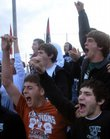 The Free State High School student section goes wild after the final out in the Firebirds' 6-4 win in boys baseball over city rival Lawrence High School on Wednesday at Ice Field. The Firebirds came back from a 4-0 deficit for the win.