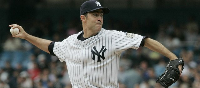 New York's Mike Mussina delivers against Cleveland. Mussina logged his 255th career victory in the Yankees' 6-3 triumph Thursday in New York.