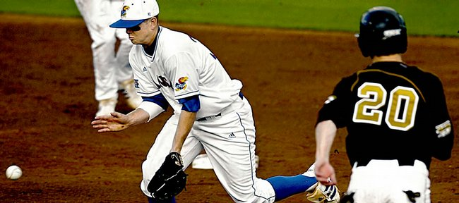 Kansas University second baseman Robby Price bobbles a grounder during the Jayhawks' 4-3 loss to Missouri. KU fell to the Tigers on Friday at Hoglund Ballpark.