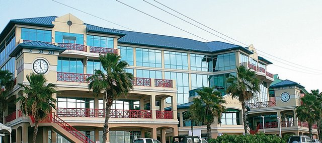 Close Brothers (Cayman) Limited has its offices in Harbour Place in George Town, Grand Cayman, as vehicles drive past. The investment house, records show, serves as a shallow footprint in the Caymans for the subsidiary of Combat Support Associates, CSA Ltd., which was established there a few months after winning its deal that has reaped more than $2 billion. The company now employs about 2,000 American citizens in Kuwait, where they support U.S. forces moving in and out of Iraq, yet there's scant evidence that CSA Ltd. exists - at least physically.