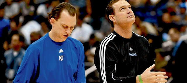 Kansas University assistant basketball coach Joe Dooley, left, tests out basketballs with head coach Bill Self at a practice at the 2008 Final Four.