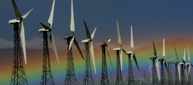 A rainbow is visible behind an array of wind turbines in this Jan. 28 file photo from Palm Springs, Calif. By the year 2030, Americans may get as much as 20 percent of their electricity from wind power, the Energy Department says.