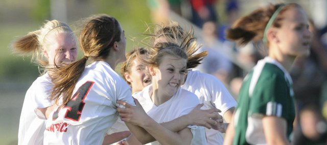 Lawrence's Marley Sutter (22) is surrounded by her teammates after her game-winning goal. After losing to Free State, 1-0, earlier in the season, the Lions defeated the Firebirds, 1-0, in the first round of the Class 6A regional tournament on Monday at Youth Sports, Inc.