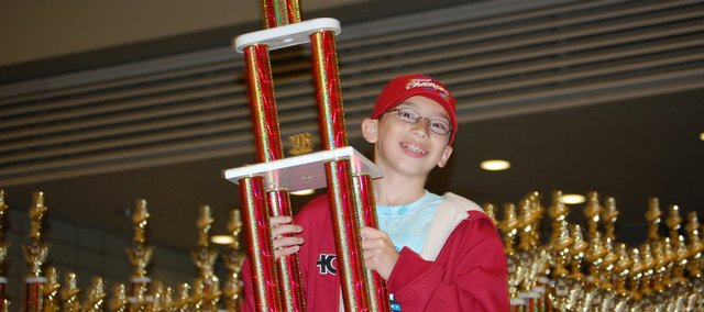 Sam Stephens, a fifth-grader at Quail Run School, displays the K-5 national championship trophy he won by beating out 406 players in his grade bracket at the National K-6 Bert Lerner Chess Championship, conducted last weekend in Pittsburgh.