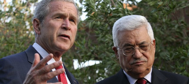 President George W. Bush, left, talks to the media while Palestinian Authority President Mahmoud Abbas listens following their meeting Saturday in Sharm el-Sheik, Egypt.