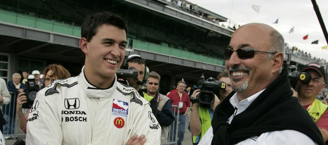 Bobby Rahal, right, congratulates his son, race driver Graham Rahal. Graham was one of 22 drivers who qualified for the Indy 500 on Saturday in Indianapolis.
