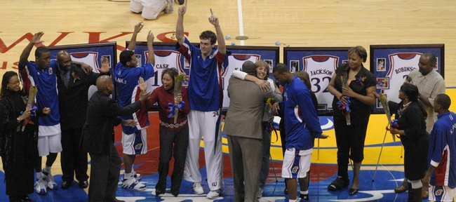 Kansas University seniors, from left, Rodrick Stewart, Jeremy Case, Sasha Kaun, Darnell Jackson and Russell Robinson meet with their parents at mid-court before their Senior Night game against Texas Tech. Case, who red-shirted his first season at KU, graduated last year, and the other four graduate today.