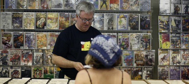Craig Klotz, of Lawrence, sells comics at his stand Sunday at the Free State FreeCon Comic Book and Toy Convention at the Douglas County 4-H Fairgrounds. Klotz organized the convention.