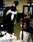 Karl Stratman, dressed as a version of Spider-Man, looks at a selection of Legos on Sunday during the Free State FreeCon Comic Book and Toy Convention at the Douglas County 4-H Fairgrounds.