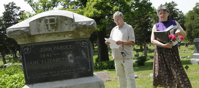 Second-cousins Bob Weis, Denver, left and Sue Davis, Olathe, search for the gravestone of their great-great aunt, Alice Pardee, Monday in Oak Hill Cemetery. The two genealogy enthusiasts recently found out about each other and decided to track down some of their common ancestors, several of whom are buried in Douglas County. Alice Pardee lived in Lawrence and died at age 104. The city celebrated her 100th birthday with a party in 1969.