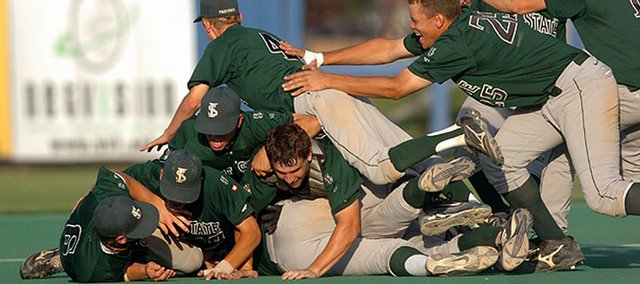 Members of the Free State baseball team start a dogpile on the mound after winning the state championship in 2006. The Firebirds have two members on the 2008 team - Jordan Dreiling and Hunter Scheib - who played regularly two years ago. Top-seeded Free State will begin its quest for another championship when it takes on crosstown rival Lawrence High at 11 a.m. today at Hummer Sports Park in Topeka.