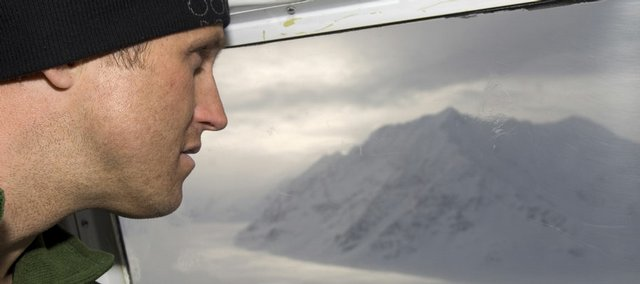 Kevin Mahoney, one of four climbers on the Big Expedition for Cancer Research, takes a last look at mountain 8290 out the window of an exploratory flight over Glacier Bay National Park, Alaska. The climbers will attempt to summit the unclimbed peak to raise funds and awareness for cancer research.