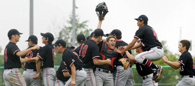 Lawrence High players celebrate after defeating Free State High on Friday in the first round of the 6A Kansas State High School baseball tournament at Hummer Sports Complex in Topeka.