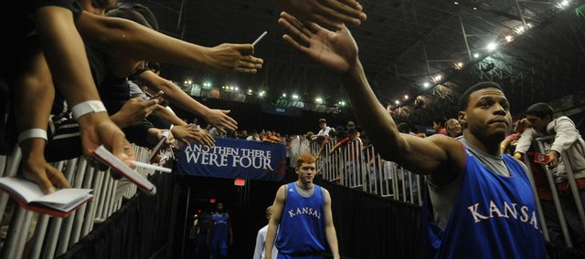 Kansas guard Brandon Rush slaps hands with fans as the Jayhawks take the court for practice in this file photo. KU worked out at the Alamodome in San Antonio on the eve of the 2008 national semifinal game against North Carolina.