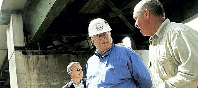 Lawrence mayor Mike Dever, from left, Gary Sandquist, chairman of United Contractors, of Johnston, Iowa, and Douglas County Commissioner Jere McElhaney walk under the Interstate 70 bridges above the Kansas River. They attended a groundbreaking ceremony Thursday conducted by the Kansas Turnpike Authority, marking the beginning of work to replace the bridges and complete other renovations to the turnpike north of Lawrence.