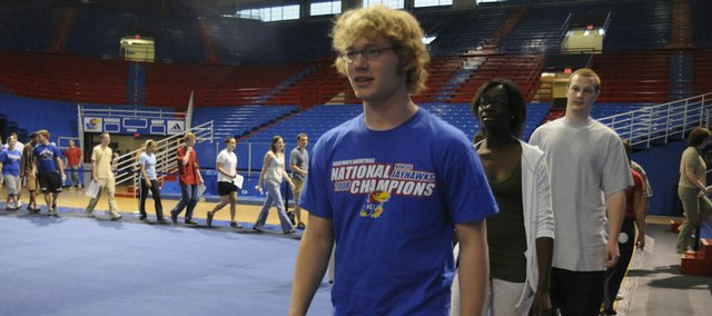 Evan Adkins leads the way in graduation practice for Free State High School seniors who gathered Friday morning in Allen Fieldhouse to rehearse for Sunday's commencement ceremony.