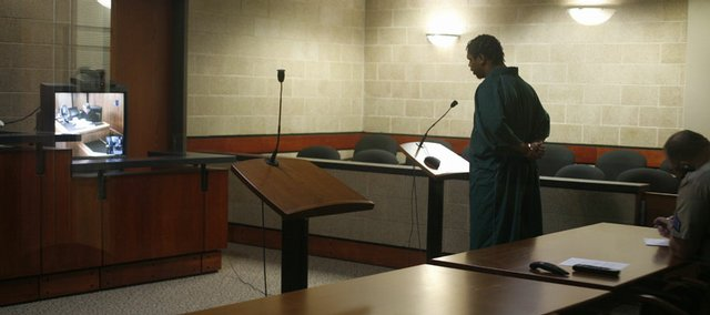 Major C. Edwards Jr., of Lawrence, makes his first court appearance in May 2008 at the Douglas County Jail in the case of the 2006 shooting of Anthony Vital. Edwards was charged with premeditated first-degree murder.