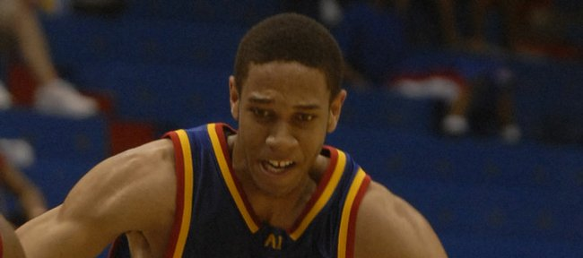 Xavier Henry (23), of Athletes First, drives the lane against Kansas City Pump N Run's Jarod McDaniel. Henry, son of former KU player Carl Henry, played in the Jayhawk Invitational at Allen Fieldhouse in this 2007 file photo.
