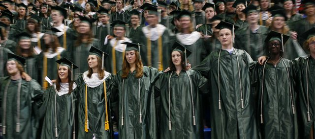 Free State High School seniors gather arm-in-arm for the last time to sing their alma mater on Sunday during the school's 2008 commencement ceremony at Allen Fieldhouse.