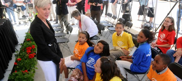 "Gov. Kathleen Sebelius chats with a group of Lawrence Boys & Girls Club members following a donation ceremony at Wal-Mart, 3300 Iowa, in which $700,000 was given to the Kansas University Center for Research on Learning. The donation, which will support the Boys & Girls Club of America's homework tutorial program ""Power Hour,"" is the largest given by Wal-Mart to a Kansas organization."