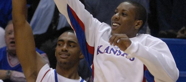 The Jayhawk bench celebrates a second-half three-pointer by guard Conner Teahan in a November 28, 2007 game against Florida Atlantic University.  Kansas University basketball players Darrell Arthur and Mario Chalmers appear to be leaning strongly toward remaining in the NBA draft.