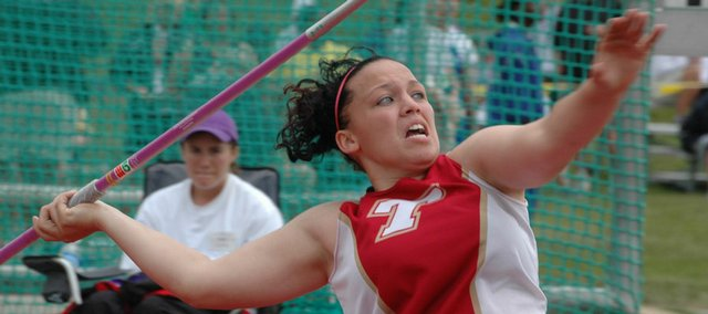 Tonganoxie High senior Roxi Grizzle lets loose with her state-title clinching throw at state.