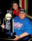 Jeff Young, shown with his wife, Abby Young, got to hold KU's 2008 National Championship basketball trophy recently. Jeff Young, 31, has been diagnosed with terminal cancer.