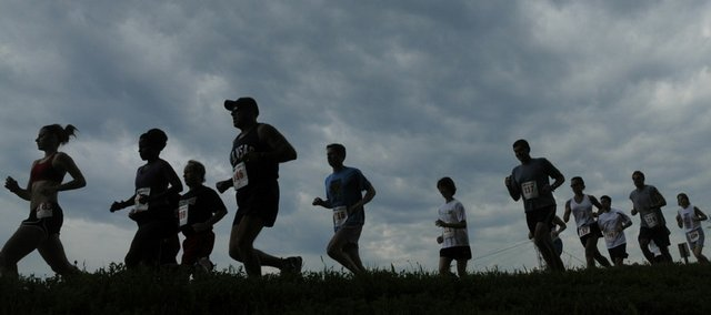 Runners participating in the 7th Annual Nash Dash start the 8K run Saturday on the Kansas River levee trail. Two events, the 8K and a Family Fun Run, were sponsored by Bert Nash Community Mental Health Center. The run raises funds for the center's Working to Recognize Alternative Possibilities program, which provides full-time in-school counseling to at-risk students in Douglas County secondary schools.