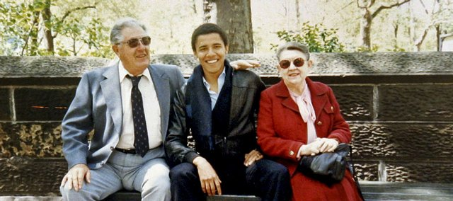 Barack Obama sits with his grandparents, Stanley and Madelyn Dunham on a park bench in New York City, in this undated photo taken when Obama was a student at Columbia University. Obama's mother, Stanley Ann Dunham, was born in Fort Leavenworth, Kan., and the Dunhams also lived briefly in El Dorado.