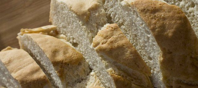 This gluten-free French bread will satisfy a desire for the crusty bread while avoiding any allergic reaction. See the recipe on page 2C. Below, a great-tasting, gluten-free pizza crust is possible with the right ingredients and technique. The dough, including sorghum and tapioca flours, is prebaked for 10 minutes before adding whatever favorite topping are desired, then finished baking for 20-25 minutes.