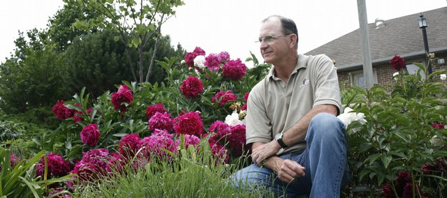 Leon Pesnell has been growing peonies since about 1992. He has more than 200 cultivars of the flowers in his garden in rural Eudora. Cooler-than-normal temperatures have prolonged the show of peony blooms this year.