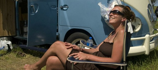 Jenn Gronoski relaxes by her Volkswagen in this 2007 file photo of the Wakarusa Music & Camping Festival.