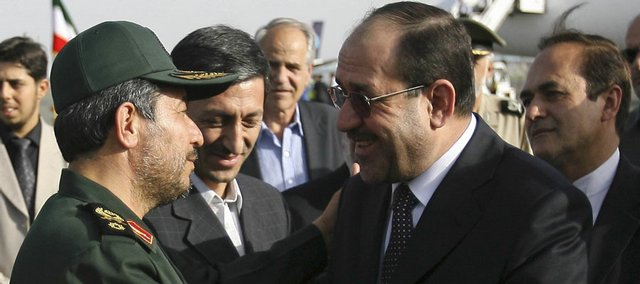 Iraqi Prime Minister Nouri al-Maliki, right, is greeted by Iranian Defense Minister Mostafa Mohammad Najjar after al-Maliki arrived Saturday in Tehran, Iran.