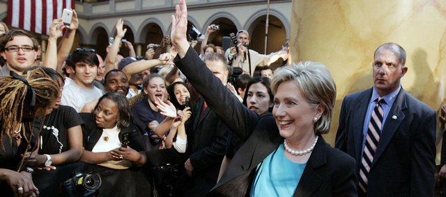 Sen. Hillary Rodham Clinton, D-N.Y., waves goodbye Saturday after addressing supporters at the National Building Museum in Washington, D.C., where she suspended her presidential campaign and endorsed Barack Obama.