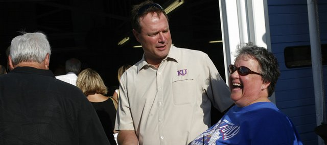 Kansas basketball coach Bill Self, center, jokes with Mary Lu Speedone, of Kansas City, Kan., during Bill's Basketball Boogie. The event Saturday at Kansas Speedway was a fundraiser for Self's Assists Foundation.