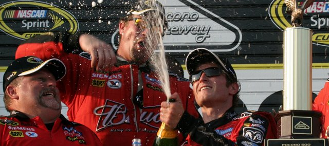 Nascar driver Kasey Kahne, right, celebrates with champagne after winning the Sprint Cup Series Pocono 500 on Sunday in Long Pond, Pa.