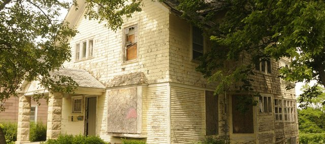 Property owners at 1232 La. would like to tear down this old home, but the city's Historic Resources Commission and the Oread Neighborhood Association are against it because of the home's historic value. The City Commission is expected to decide the home's fate at tonight's meeting.