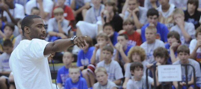 Former Kansas University basketball player Keith Langford speaks at the Bill Self Basketball Camp. Langford and former teammate Aaron Miles made appearances at the camp Monday afternoon in Horejsi Center.