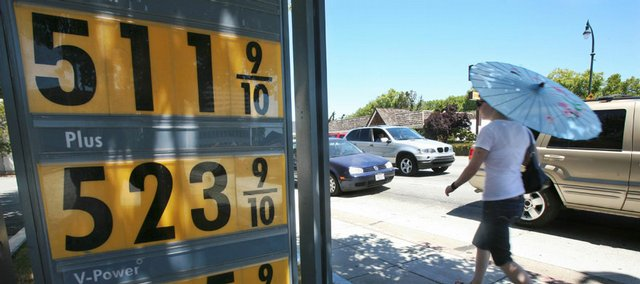 A woman walks past the price board Tuesday at a Shell gas station in San Mateo, Calif. The U.S. Senate failed to take up an energy package Tuesday that would have taxed billions of dollars on profits from the country's biggest oil companies.