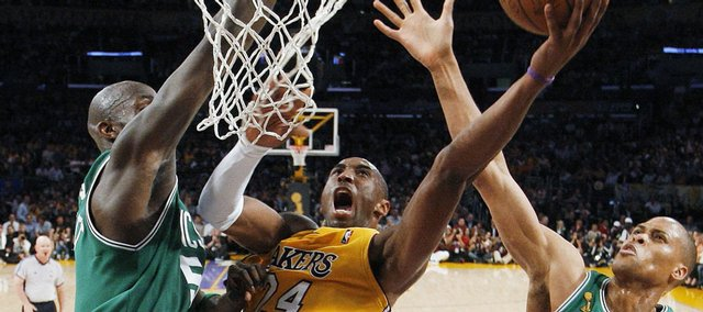 Los Angeles Lakers' Kobe Bryant, center, drives to the basket between Boston's Kevin Garnett, left, and P.J. Brown. Bryant scored 36 points, leading the Lakers to an 87-81 victory Tuesday in Los Angeles.
