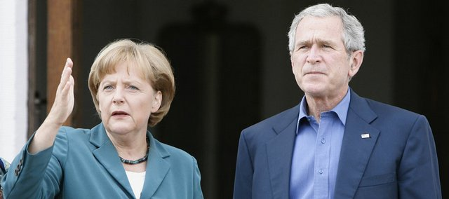 U.S. President George W. Bush, right, is welcomed by German Chancellor Angela Merkel upon his arrival at a government guest house in Meseberg, north of Berlin. Bush is on a two-day visit to Germany during his weeklong trip to Europe.