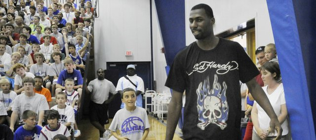 Julian wright, Former KU basketball player and current forward for the New Orleans Hornets, is introduced at the Bill Self Basketball Camp. Wright made an appearance at the camp in this 2008 file photo.