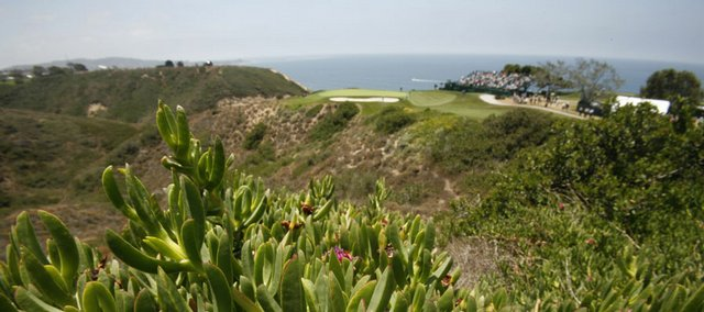 Competitors practice on the third green of the Torrey Pines Golf Course in the background. The U.S. Open will start today on the picturesque course in San Diego.
