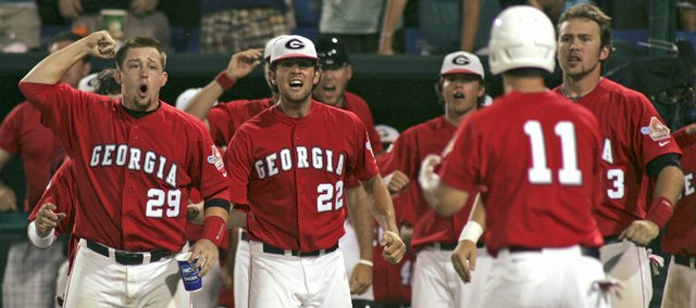 Georgia's bench celebrates after teammate Lyle Allen (11) scored against Miami in the ninth inning of the NCAA College World Series. Georgia defeated Miami, 7-4, on Saturday in Omaha, Neb.