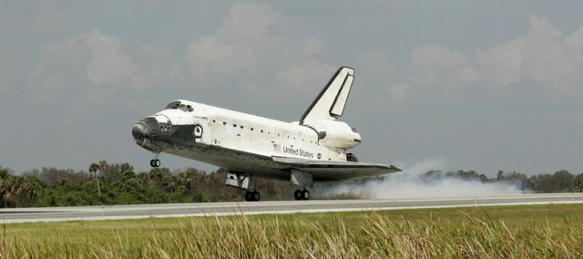 Space shuttle Discovery lands Saturday at Kennedy Space Center in Cape Canaveral, Fla., capping a successful expansion job at the international space station.