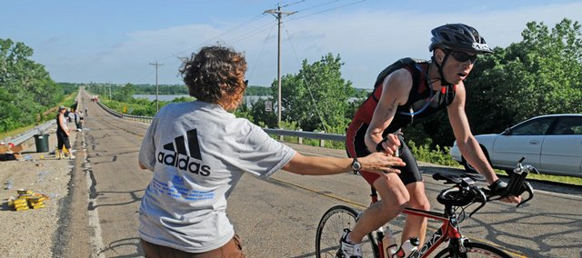 Tom Ruzicka, of Kansas City, Mo., snags some water from a volunteer.
