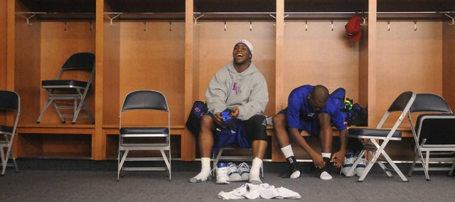 Kansas University guards Sherron Collins, left, and Russell Robinson suit up for practice in the team locker room at Ford Field before their 2008 Sweet 16 matchup with Villanova.  On Monday a Douglas County judge ordered Collins to pay damages in excess of $75,000 to a woman who filed a civil suit against him, accusing him of assault.