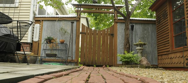 Mike Pisani uses recycled brick for nearly all of his walkways at his home in the 500 block of Illinois.