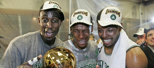 Boston's Kevin Garnett, left, Ray Allen, center, and Paul Pierce celebrate in the locker room. The Celtics clinched their 17th NBA title Tuesday in Boston.